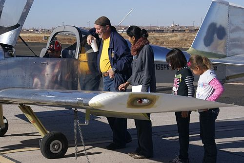 Patrick Kelley gives a young man a cockpit tour while other kids wait their turn.
