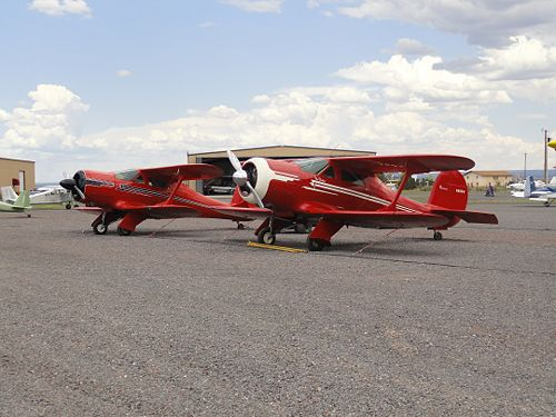 A visiting Staggerwing Beechcraft sits beside the one based at Valle.